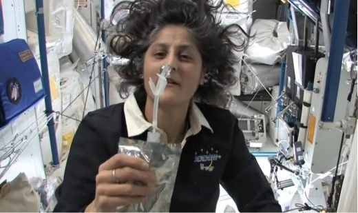 female astronaut drinking water in space - photo #16